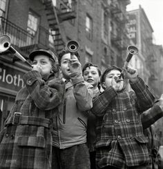 """January 1, 1943. """"New York. Blowing horns on Bleecker Street on New Year's Day."""""""