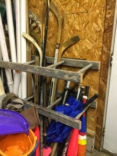 Here's a garage organization tip!  Cut an old wooden latter in half and anchored them to the wall, lining up the rung holes for those long items.  Notice I put one half lower to place all of our baseball bats and umbrellas.  As you work your way over, notice the longer hockey sticks, wood trim and plumbing tubing.   I'm going to cut another ladder for my gardening tools like shovels, rakes, etc.  The possibilites are endless!