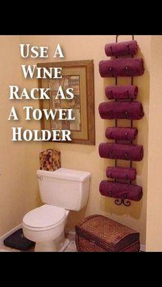 DIY Home Decor Idea: Wine Rack as a Towel Holder for a small bathroom Bathroom Organization, Bathroom Storage, Organization Hacks, Bathroom Ideas, Bathroom Towels, Bath Towels, Downstairs Bathroom, Pool Towels, Design Bathroom