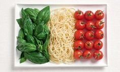 Italy, this is a cool picture of using basil, spaghetti and tomatoes to form the colors of the Italian flag
