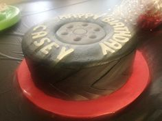Car Tire Cake made for a birthday by Patsy's Sweet Shoppe in West Allis, WI.  Nice tire treads on the sides.  The writing is made to look like a Goodyear tire.
