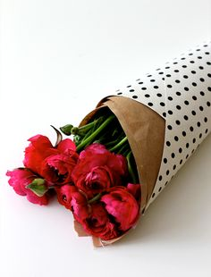The best way to receive flowers~ wrapped up in polka dots!