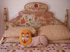 antique painted headboard, bed, quilt, lion