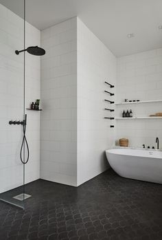 I love the continuation of the theme from Joanna Laajisto. Black shower hardware, black towel rods, black tub tapware. They all sit peacefully in this calm, white bathroom. via www.L-2-Design.com