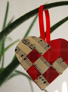 just add more sprinkles: Christmas Ornament [Norwegian Woven Paper Heart] Music Christmas Ornaments, Paper Christmas Decorations, Christmas Hearts, Paper Ornaments, Noel Christmas, Homemade Christmas, Scandinavian Christmas Ornaments, Sheet Music Ornaments, Christmas Gifts