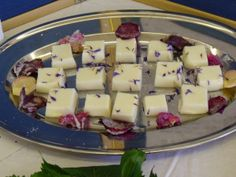"""Almond Leache, a Tudor Era Christmas Dessert-""""Take a quart of almond milk and three ounces of gelatine, half a pond of beaten sugar; stir them together. Let it  be thick. Then strain it with three spoonfuls of rosewater. Then put it into a platter and let it cool, and cut it in squares. Lay it fair in dishes, and lay gold upon it."""""""