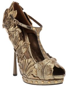 ALEXANDER MCQUEEN--I love these, but I'd last for less than  5 minutes in them.  Too bad.