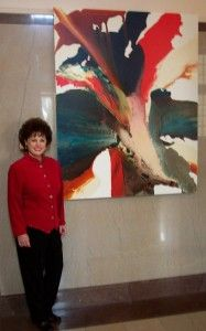 Krispen Spencer with one of her paintings