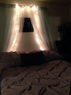 My $15.00 over the bed decor !! IKEA - both curtains $14.00 rod $1 lights -neighbors un used Christmas lights (thanks Mel)