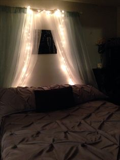 My $15.00 over the bed decor !! IKEA - both curtains $14.00 rod $1 lights -neighbors un used Christmas lights (thanks Mel)