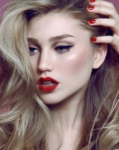 The standard winged liner paired with blood red lip color