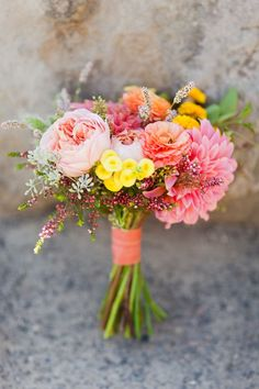 Whether the big day is in early or late spring, we love these fresh and pretty spring wedding bouquet ideas. Think pink, orange, yellow and lots of detail!