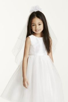 Your flower girl will look adorable as she paves your way down the aisle in this puffy top veil.  Tulle flower girl veil with flower puff detailing. To care for your veil, hang and steam.  Imported.