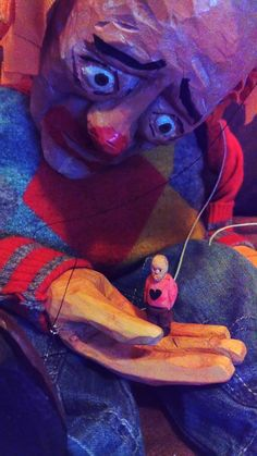 Sad Clown with a little friend. Wooden marionette.