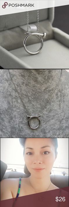 """✨Back In Stock✨Nail Necklace Stainless Steel This gorgeous Nail Necklace is made with quality stainless steel material. High polished, Silver color. Unlike sterling silver, stainless steel does not tarnish. Delicate and edgy look!      Circle nail pendant is 2cm in diameter. Necklace chain is 16"""" with 2"""" extender.          Each necklace comes with a jewelry velvet pouch. Stainless steel jewelry is ideal for daily use because of its strength. 💪🏼✨💛 Jewelry Necklaces"""