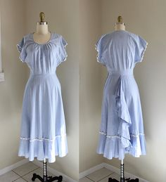 1940s Cotton Dress / Spring Flutter Dress / Vintage 40s Day Dress with Bustle / XS by CaramelVintage on Etsy https://www.etsy.com/ca/listing/276950870/1940s-cotton-dress-spring-flutter-dress