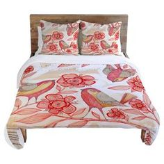 Multicolor duvet cover with a bird and floral motif. Designed by artist Cori Dantini.  Product: Duvet coverConstruction Material: 100% Woven polyesterColor: MultiFeatures:  Hidden zipper closureInterior ties to attach comforter to duvet coverMulticolor top reverses to solid cream backingSix Note: Pillows not included Cleaning and Care: Machine wash cold and tumble dry low J