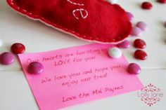 Bursting with love...felt candy heart.   >>>Cut out a heart from felt, stitch together, fill with Valentine's Day M&M's, stitch closed, mail for a fun suprise!!