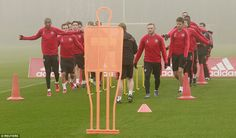 The players take part in some light running drills to get the blood pumping around their muscles