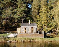 A Private Sauna on a Swedish Fjord. Glad in larch wood paneling and heavy glass window panes, the minimalist dry sauna was built with patination in mind as the materials age with wear and weather. For more information, visit General Architecture. Swedish Sauna, Private Sauna, Box Architecture, Contemporary Architecture, Larch Cladding, Stockholm Archipelago, Sauna Design, Little Cabin, Small Buildings