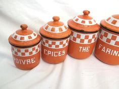 This lovely set of RARE French CLASSIC canisters has a very attractive orange and raised white checks pattern on the body all around to the top , a Lustucru design all around the container and lids.   A pretty orange background with heavy layer of enamel and thick tole This Beautiful French enamelware Canister set is complete and includes 6 Canisters with lid. A great marbled enamel lining inside!  These canisters measures , largest: 7 3/4 tall , 5 1/4 wide , smallest :4 3/4 ta...