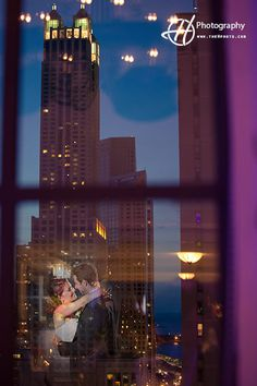 Wedding Photo from Warwick Allerton Hotel Chicago with Colleen and Jon. Photo taken by Claudia Halip for H Photography. Window reflection of the bride and groom kissing.