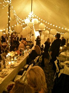 This tent, complete with lights and hanging balls sets the scene for a picturesque father-daughter #wedding dance.