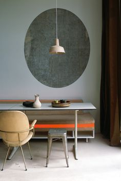 Dining area A mix of raw and finished materials add textural interest to the interior. In the open-plan dining area a...