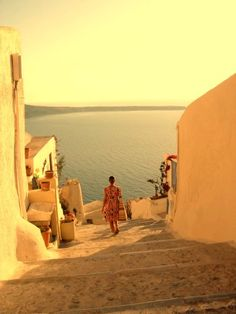 Santorini, Greece, from pinknailsinparis. This is utterly divine. It is simply sublime. Words cannot express the delightfulness of this place. I would roll down those steps, bound and tied, to follow that girl, banging my head on each stair. Would I care? No. I would be in Greece!!