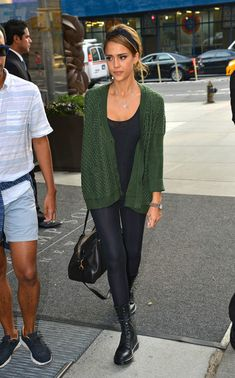 Jessica Alba steps out in a green cardigan, leggings and boots as she checks out of her New York City hotel.