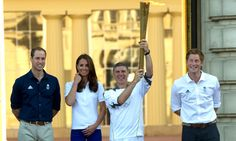 The Duke and Duchess of Cambridge and Prince Harry welcome the Olympic Torch at Buckingham Palace