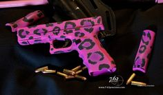 who wouldn't want a pink leopard print glock?