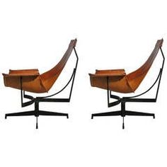 Incredible pair of architectural and sculptural sling lounge chairs by William Katavolos. These lounge chairs are the epitome of style and comfort.