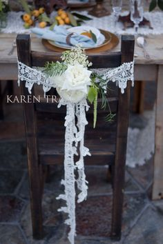 Dress your chair with crochet lace, twine and a wild rose. Beautiful....