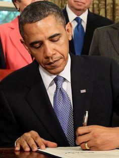 U.S. President Barack Obama stands during the posting of colors at ...
