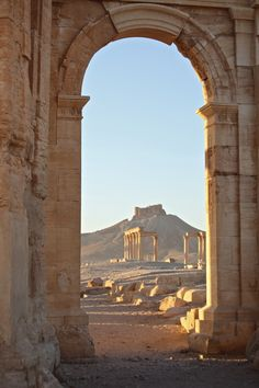 Arched Door way Vista Ancient City Landscapes of Palmyra The UNESCO World Herita.-Arched Door way Vista Ancient City Landscapes of Palmyra The UNESCO World Heritage Site Syria Middle East palmyra, syria Ancient Architecture, Art And Architecture, Ancient Buildings, Architecture Details, Middle East Destinations, Travel Destinations, Arched Doors, City Landscape, Travel Aesthetic
