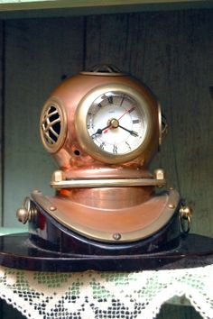This reminds me of Tarpon Springs, Florida with the sponge divers! Brass Diving Helmet Clock at  Antiques at Gresham Lake #Raleigh #NC greshamantiques.com