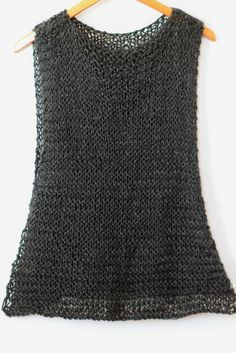 Hi friends! Since starting this blog, I've made some sort of knit tank pattern each summer. Last year, I made the Summer Vacation Knit Top which I really enjoyed. This year's pattern is probably the most beginner friendly tank yet, and it doubles as both a tank and a cover-up.  You know how peeps say ladies should all have that 'little black dress'? Well, I think I prefer 'little black' knit tanks. ;) While this one is made in black, I know that most folks aren't...