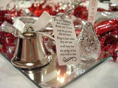 "Kissing bell instead of guests clinking glasses. The tag says ""This tiny wedding bell salutes the bride and groom And the joy that fills this room Ring it loud when they are near So all may hear The pledge of love they hold so dear."""