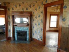 Nice tile fireplace and iron proscenium just like Chelsea.  Oak surround.
