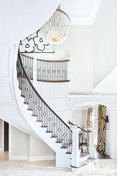 Interior designer Julia Buckingham Edelmann designed the grand staircase. White Staircase, Staircase Railings, Curved Staircase, Grand Staircase, Stairways, Staircase Ideas, Banisters, Wrought Iron Stairs, Iron Stair Railing