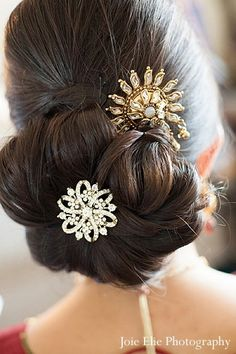 This bride prepares for her Indian wedding ceremony with beautiful hair and makeup.