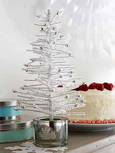 Craft a Mini Tree from pipe cleaners! Learn more about this idea: http://www.bhg.com/christmas/decorating/holiday-decorating-ideas-small-spaces/#page=25