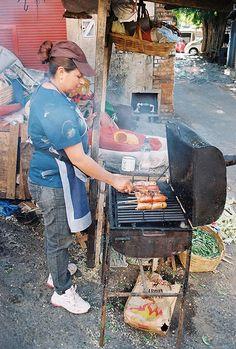 cooking sausages, street food, Mercado 4, Asuncion, Paraguay