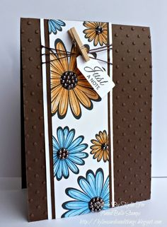 Love the colour combo, and the clothespin idea, and the flowers.
