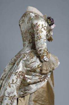 Dinner dress, 1878. Silk brocade, lace, silk satin. Emile Pingat, France ---  http://digitalcollection.chicagohistory.org/cdm/compoundobject/collection/p16029coll3/id/700/rec/24