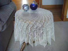 Summary Circular lace shawl knit in 32 sections.