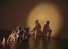 Real Life is Rubbish, 2002  British-born and -based artists Tim Noble and Sue Webster skilfully skirt the boundaries between beauty and the shadowier aspects of humanity, playing with our perceptions as well as our notions of taste. Many of their most notable pieces are made from piles of rubbish, with light projected against them to create a shadow image entirely different to that seen when looking directly at the deliberately disguised pile.