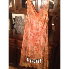 Dress Barn Brand Sleeveless Dress This is a very cute spring time/ summer dress.   Sleeveless dress with fringed edge.   Size 16W Dress Barn Woman Brand.   Cute orange dress with Brown and Beige Floral Designs through out.   One piece dress.   100% Polyester and machine washable. Dress Barn Dresses