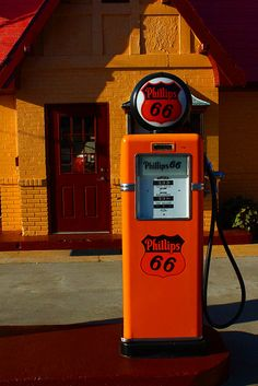 The Route 66 Visitors' Center in Baxter Springs, Kansas is a restored Phillips 66 service station. Old Water Pumps, Old Gas Pumps, Vintage Gas Pumps, Phillips 66, Pompe A Essence, Old Garage, Old Gas Stations, Filling Station, Oil And Gas